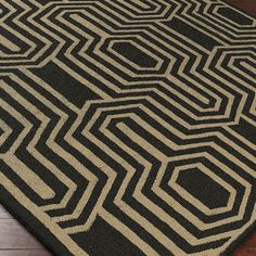 Wool rug with a concentric geometric motif. Hand-woven in India.  Product: RugConstruction Material: 100% Wool