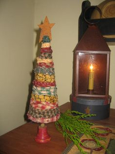 Christmas Tree made with wrapped fabric Primitive Christmas Crafts, Christmas Tree Crafts, Christmas 2015, Christmas Projects, Fabric Christmas Trees, Prim Christmas, Homemade Christmas, Holiday Crafts, Yule Crafts