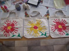 DD and I created these tote bags with her handprint flowers for teachers for Teacher Appreciation week. Idea came from paintcutpaste.com.