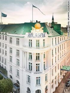 """Hotel Atlantic Kempinski, Hamburg, Germany - Bond scrambles over the iconic, globe-adorned rooftop of the Atlantic Kempinski in """"Tomorrow Never Dies,"""" and the hotel's exterior also appears throughout the film. Bond, played by Pierce Brosnan, stays in the hotel's Atlantic Suite and several scenes were filmed there. An der Alster 72-79,20099 Hamburg; +49 40 28880; from $213 per room per night"""