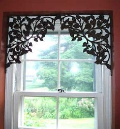 Use brackets to decorate a window that doesn't need to be covered up with curtains. | 31 Easy DIY Upgrades That Will Make Your Home Look More Expensive