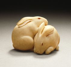 Kaigyokusai (Masatsugu) (Japan, Osaka, 1813-09-13 - 1892-01-21) Rabbit Pair, mid- to late 19th century Netsuke, Ivory with inlays,