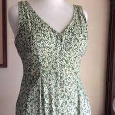 Floral Rayon Sundress A-Line Floral Sundress, mid-length with 10 button closure. Upper back is gathered. Nice and comfortable on a hot summer day. Great condition. Express Dresses Midi