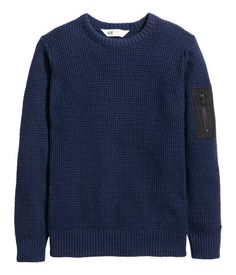 Dark blue long-sleeved sweater in a soft, textured knit with woven details.