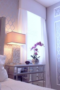 Purple aubergine master bedroom. Grey walls. Casablanca wall stencil. ZGallerie bed. Love the window treatment