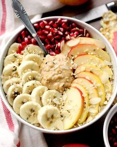 Just a bowl of vanilla oats topped with banana, an apple, pomegranate and peanut butter