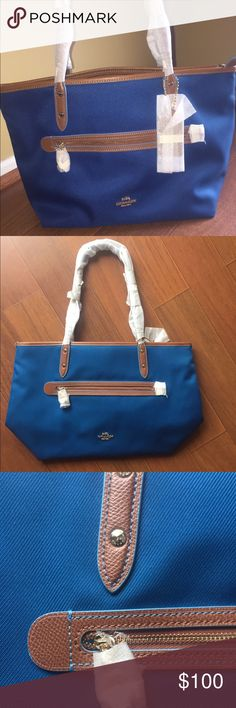 """Coach Sawyer Tote in Beautiful Bright Mineral Blue Coach Sawyer Tote in Beautiful Bright Mineral Blue   • Retails $250  Polyester Twill • Outside & Inside Zip pockets - 2 inside slip pockets Zip Closure • Gold Colored Hardware with Saddle Leather accents & a Beautiful Bright Blue Satin lining Interior • Measures appr. 9 1/2"""" tall (without handles) x 15"""" wide (measured across top zipper) x 5 1/2"""" deep 9"""" handle (measured from top of handle to top of tote) Coach Bags Totes"""
