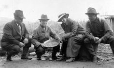Circa between 1900 and 1916, Alaska. Group portrait of a woman and three men, crouched outside, smiling; one of the men is displaying a dish of panned gold. LC-DIG-ppmsc-01705 http://www.loc.gov #American #History #Alaska #GoldRush