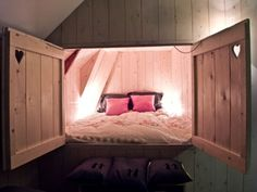 Bed inside the wall with barn doors. So cool :)