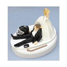 Pittsburgh Penguins Hockey Wedding Cake Topper found on Polyvore - I have this topper, minus the hockey gear... I know what I'm gonna add to it if I ever get married!