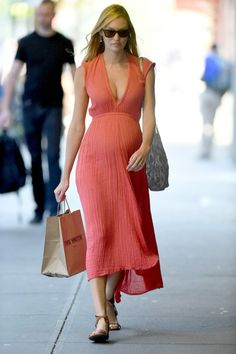 Model-Off-Duty Maternity fashion style: Candice Swanepoel in salmon color summer dress. Cute Maternity Outfits, Stylish Maternity, Pregnancy Outfits, Maternity Wear, Maternity Fashion, Maternity Dresses, Pregnancy Fashion, Summer Maternity, Celebrity Maternity Style
