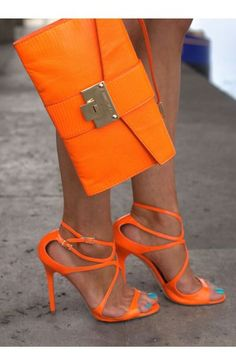 Neon orange Jimmy Choo envelope bag and sandals