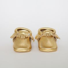 """Gold - Limited Edition Moccasin.  Ok, not normally a """"ooh how cute, baby shoes!"""" kind of gal, but I mean...come on!"""