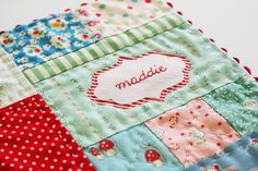 placemat by nanaCompany... love the way she mixed and matched pretty fabrics.