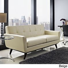 Gently sloping curves and large dual cushions create a favorite lounging spot in this comfortable loveseat. The Engage loveseat is a welcome presence in any home, with five tufts for eye-catching appeal, this loveseat is upholstered in smooth leather.