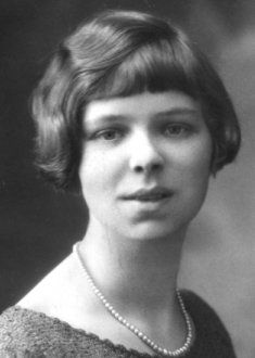 The charleston cut.  A softer, more feminine bob popular around 1925.  Like this, says the woman with naturally curly hair!