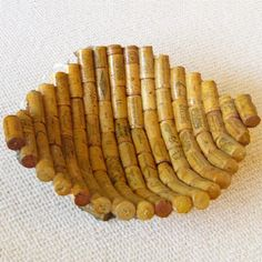 "Wine Corks Recycled Bowl - glue around a balloon or an existing bowl to get the right shape. Hmmm stepmoms next present maybe?""?"