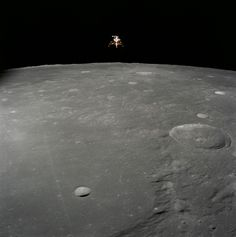 The Apollo 12 Lunar Module (LM), in a lunar landing configuration, is photographed in lunar orbit from the Command and Service Modules (CSM) on Nov. 19, 1969. Aboard the LM were astronauts Charles Conrad Jr., commander; and Alan L. Bean, lunar module pilot.
