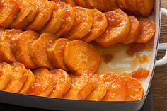 Baked Ginger Sweet Potatoes ~ The glaze for these sweet potatoes is made from orange juice, apricot preserves, and spicy ginger, plus a bit of salt to balance out the sweetness. Once the glaze is made, shingle the sweet potato rounds in a baking dish and baste them with the glaze as they bake.