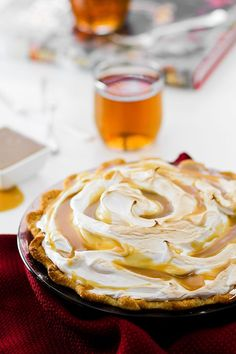 Butterbeer Pie that even Harry Potter would most definitely approve of! Buttery and sweet, this creamy pie tastes just like the popular beverage.  YOU GUYS I MADE YOU BUTTERBEER PIE THIS IS A REAL THI
