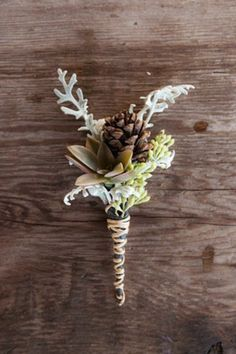 Use pinecones and succulents in your flower arrangements. | 42 Lovely Ideas For A Cold-Weather Wedding