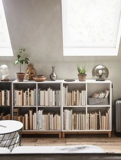 living / EKET Ikea / Low shelves are filled with books and hold decorative items and plants on top. Low Bookshelves, Low Shelves, Ikea Shelves, Ikea Book Shelves, Storage Shelves, Ladder Bookcase, Living Room Shelves, Living Room Decor, Home Libraries