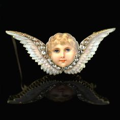VICTORIAN.c1885.Beautiful enamal and diamond cherub brooch
