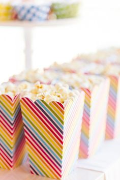 Light, airy, and inexpensive, individually portioned popcorn makes for the perfect party treat.  Source: The TomKat Studio