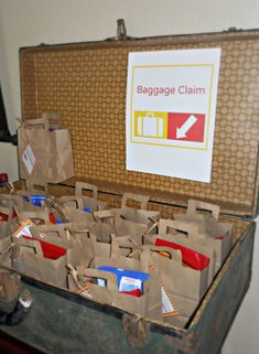 I like how they used brown paper bags and cut them to look like luggage  airplane party baggage claim favors