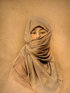 Japanese woman in the late 1880's in winter wear.