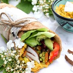 Vegan Wholegrain Naan Wrap with Curry Hummus, grilled vegetables and fresh Coconut.