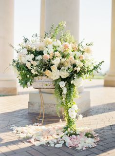 I believe we're getting peach, white and green floral arrangements in wine barrel containers made for us. I love the cascading look, though this looks too forced. | Flowerwild Designs Ceremony Decorations, Flower Decorations, Wedding Centerpieces, Wedding Bouquets, Amazing Flowers, Love Flowers, Romantic Flowers, White Flowers, Pink Roses