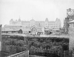 View from Sparks Street of Parliament Hill under construction, Ottawa, Ontario, Canada, c. 1860.
