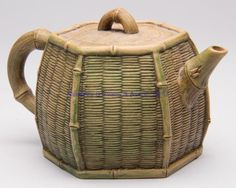 Chinese Yixing Zisha Clay Teapot in the form of a hexagonal wicker basket with a bamboo handle
