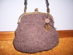 Bolso de Tweed con boquilla metalica.