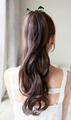 Black ribbon in long hair. pretty