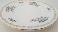 Check out this item in my Etsy shop https://www.etsy.com/uk/listing/399314777/royal-grafton-fine-bone-china-cake-plate