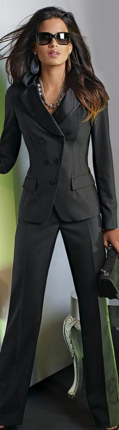 Now this is a power suit! Sophisticated and a bit sexy, charcoal gray/espressro suit with clean lines.  Larger accessories add a little spice.  More conservative look would include smaller earrings (hoops or even pearls) Wear with neutral shoes.  #suits #womens #fashion