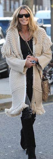 Who made Elle Macpherson's sweater knit coat and snakeskin handbag? Sweater – Stefanel  Purse – Jimmy Choo