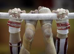 Bridget Sloan, of the United States, competes in the uneven bars during the artistic gymnastics team qualifications at the Pan American Games in Guadalajara, Mexico, Monday, Oct. 24, 2011.(AP Photo/Dario Lopez-Mills)