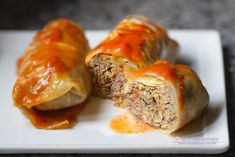 Mom's Classic Stuffed Cabbage Rolls Mom's Classic Stuffed Cabbage Rolls,Recipes No summer cookout is complete without a tray of stuffed cabbages! Tender cabbage leaves stuffed with rice, seasoned ground meats and a rich tomato. Best Cabbage Rolls Recipe, Easy Cabbage Rolls, Cabbage Recipes, Cabbage Ideas, Salmon Recipes, Cabbage And Beef, Baked Cabbage, Stuff Cabbage, Cooking Tv