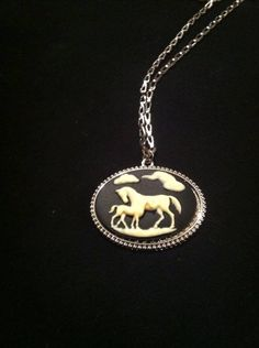 "Horse cameo necklace On 16"" silver coloured chain $18"