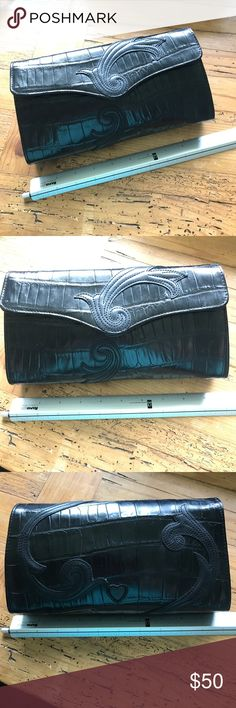 """Black leather Brighton purse clutch wristlet swirl Approximately 9.75"""" x 5.25 x 2.  Excellent condition.  Very lightly used. Optional wristlet feature. Magnetic closure. Purse. Wristlet. Clutch.  Black leather made to look like an animal print. Possibly alligator gator crocodile snake - not sure.  Swirl on front and back.  Heart on back.  There is hardware on the purse to attach a strap but I don't have a strap to go with it. Brighton Bags Clutches & Wristlets"""