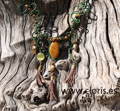 TIGER medium-colored necklace of gold, brown, green and yellow colors with tiger's eye, hematite, cat's eye and jasper. Ideal for women with copper brown hair and long and thin neck. For summer and tribal or ethnic look.  #casual #fashion #accesories #ethnic #handmade #handcraft #chic #boho #tribal #madeinspain #madeineurope #love #woman #present #gift #original #new #ibiza #lovely #awesome #style #valencia #design #boho #bohochic #necklace #leather #gemstones #tigereye #cateye #hematite…