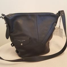 227b08a24809 Marc Jacobs NWT convertible sling the mini bag Description The convertible Sling  Bag shrinks down in this new petite Marc Jacobs bag that can truly go with  ...