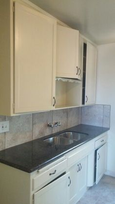 """Completed Project #2. Uba Tuba Granite Kitchen Counter Top with 18""""×18"""" Procelan Tile with Orginial Wooden Cabinets."""