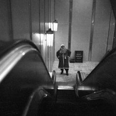 Father Christmas contemplates the escalator, at Harrods department store. London, 1953