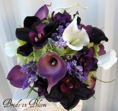 "This Wedding bouquet has class and elegance. Real touch calla lilies & orchids are soft to touch and look so real, you are sure to love them. Bouquet is designed with 10 eggplant & white calla lilies, 3 plum orchids, hydrangea, lavender & plum delphinium, framed with curly willow loops and grass. Handle treatment is wrapped with a plum satin overlay ribbon and a white satin ribbon sash, completed with a sparkling rhinestone buckle. Bouquet measures 10"" ( 25 cm ) wide x 12""…"