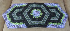A personal favorite from my Etsy shop https://www.etsy.com/listing/254463625/purple-pansies-table-runner-green-black