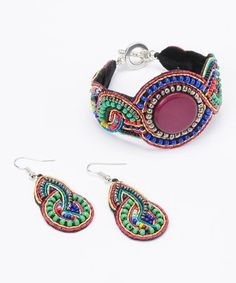 This Purple Wave Seed Bead Bracelet & Earrings is perfect! #zulilyfinds #jewelry #jewelrysale #sale #fashion #fashionjewelry #pavcusdesigns #pavcus #womensfashion #womensjewelry #bling #falljewelry #fall #bracelet #earrings #necklace #jewelryset #giftidea #fallfashion #beadedjewelry